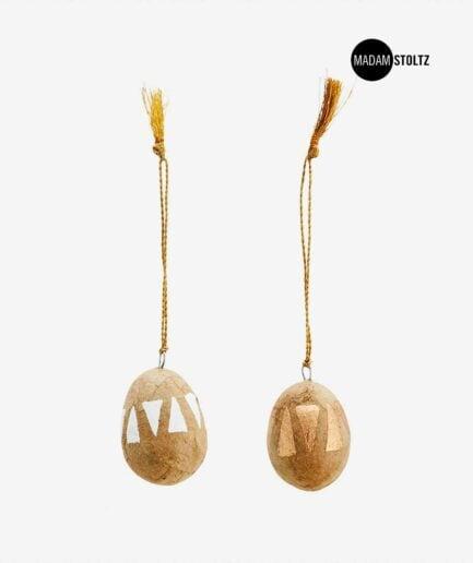 Ostereier im Boho Stil mit goldenen Mandala Muster von der Marke Madam Stoltz. Traumhaft schöne Oster Deko im Bohemian Stil für das schönste Ostern