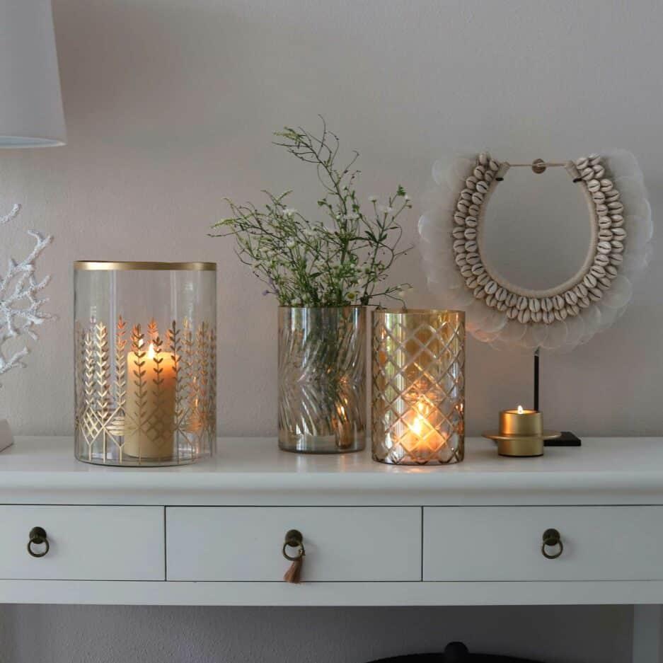 Windlichter in Gold und Champagner aus Glas, die auch als Vase perfekt elegant sind